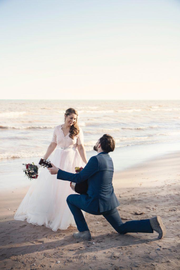 bride, groom, sand beach guitar