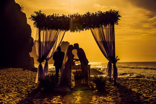 Arbour, bride and groom, floral arbour sand and ocean