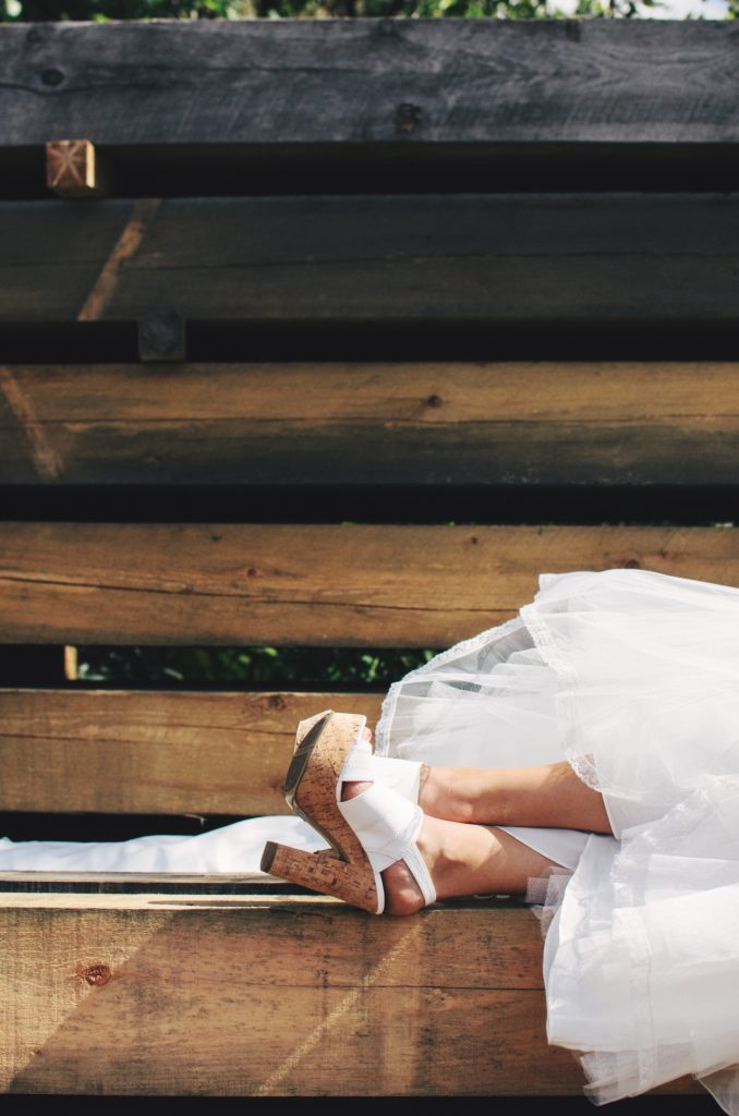 woman, bridal gown, feet up, white high heels